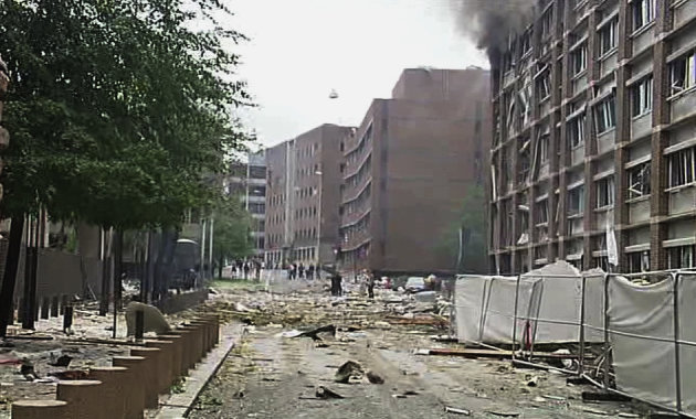 In this video image taken from television, smoke is seen billowing from a damaged building as debris is strewn across the street after an explosion in Oslo, Norway Friday July 22, 2011. A loud explosion shattered windows Friday at the government headquarters in Oslo which includes the prime minister's office, injuring several people. Prime Minister Jens Stoltenberg is safe, government spokeswoman Camilla Ryste told The Associated Press. (AP Photo/TV2 NORWAY via APTN) NORWAY OUT