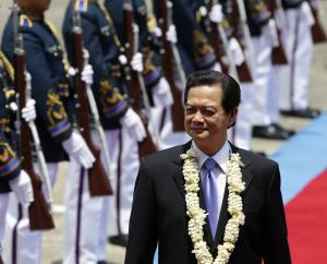 Vietnamese Prime Minister Nguyen Tan Dung walks past …
