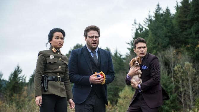 "This photo provided by Columbia Pictures - Sony shows, from left, Diana Bang, as Sook, Seth Rogen, as Aaron, and James Franco, as Dave, in Columbia Pictures' ""The Interview."" (AP Photo/Columbia Pictures - Sony, Ed Araquel)"