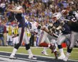 New England Patriots quarterback Tom Brady throws the ball away form the end zone during the NFL Super Bowl XLVI football game against  the New York Giants in Indianapolis Indiana