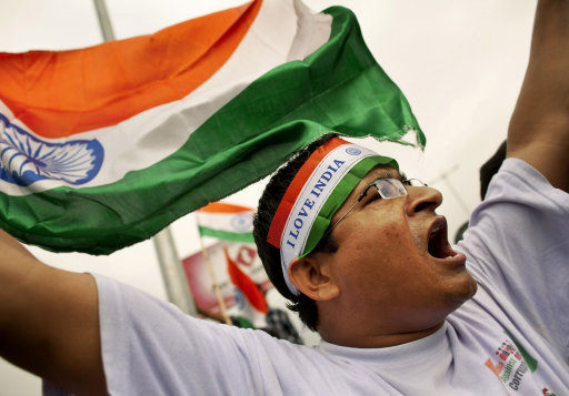 A supporter of Indian rights activist Anna Hazare shouts slogans after Hazare was detained prior to beginning a hunger strike in New Delhi, India, Tuesday, Aug. 16, 2011. The prominent activist who had announced an indefinite hunger strike to demand tougher anti-corruption laws was detained early Tuesday morning, police said. (AP Photo/Kevin Frayer)