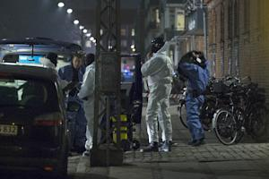 Forensic police officers work at the area around a…