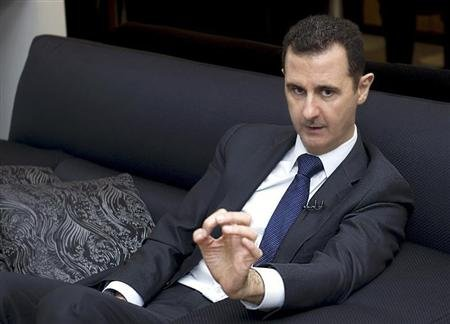Syria's President Bashar al-Assad speaks during an interview with a German newspaper in Damascus
