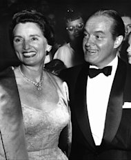 "FILE - In this 1955 file photo, entertainer Bob Hope, right, and his wife Dolores attend the premiere of Hope's movie ""The Seven Little Foys"" at a Paramount Theater in Los Angeles. Dolores Hope, who was married to Bob Hope for 69 years and sang at his shows, died Monday, Sept. 19, 2011 of natural causes at home in Los Angeles. She was 102. (AP Photo, file)"