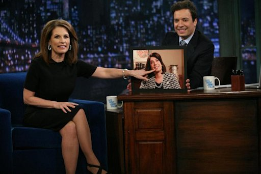 "In this image released by NBC, Republican presidential candidate Michele Bachmann, of Minnesota, left, points to a photo of host Jimmy Fallon, dressed as Bachmann, during a visit to ""Late Night with Jimmy Fallon,"" that aired early Tuesday, Nov. 22, 2011 in New York. (AP Photo/NBC, Lloyd Bishop)"