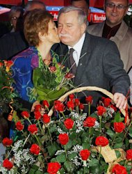 """FILE - In this Sept. 30, 2003 file photo Lech Walesa, Poland's Solidarity leader and former president, gets a kiss from his wife Danuta, during a birthday party in Gdansk, Poland. Walesa, the democracy icon and Nobel peace prize winner, has sparked controversy and outrage in Poland by saying in a TV interview Friday, March 1, 2013, homosexuals have no right to a prominent role in politics and that as a minority they need to """"adjust to smaller things"""" in society. (AP Photo/Czarek Sokolowski, File)"""