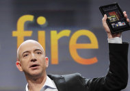 Jeff Bezos, Chairman and CEO of Amazon.com, introduces the Kindle Fire at a news conference, Wednesday, Sept. 28, 2011 in New York. The e-reader and tablet has a 7-inch (17.78 cm) multicolor touchscreen. (AP Photo/Mark Lennihan)