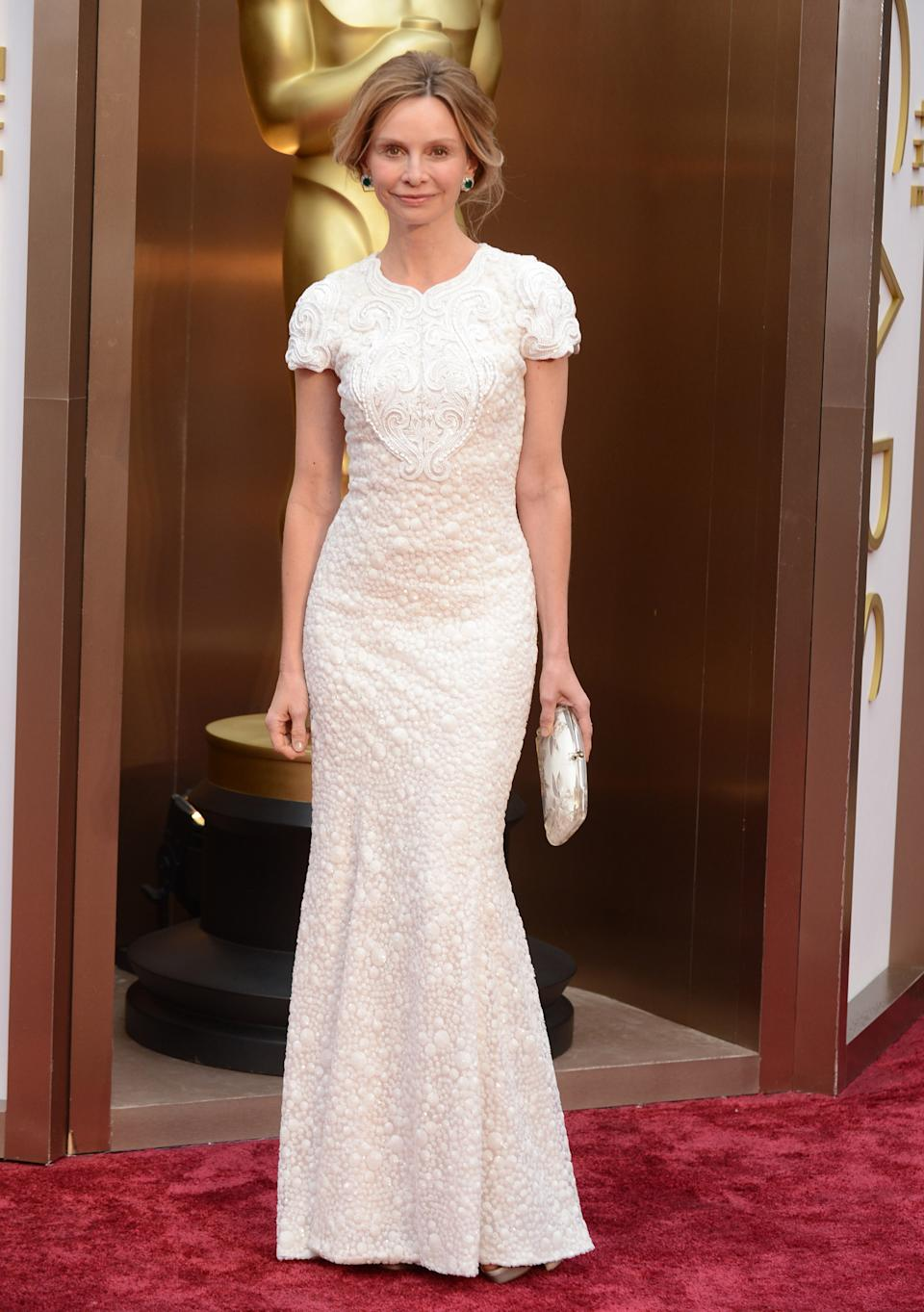 Calista Flockhart arrives at the Oscars on Sunday, March 2, 2014, at the Dolby Theatre in Los Angeles. (Photo by Jordan Strauss/Invision/AP)