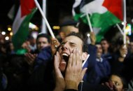 "A Palestinian man shouts slogans during a rally in the West Bank city of Ramallah November 29, 2012. The 193-nation U.N. General Assembly overwhelmingly approved a resolution on Thursday to upgrade the Palestinian Authority's observer status at the United Nations from ""entity"" to ""non-member state,"" implicitly recognizing a Palestinian state. REUTERS/Marko Djurica"
