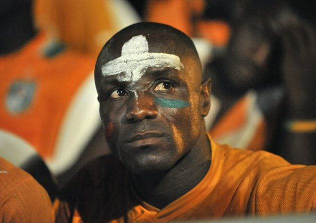 A Supporter Of The Ivory Coast's National Football Team Watches AFP/Getty Images