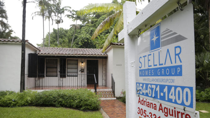 In this Wednesday, Oct. 7, 2015, photo, a home is for sale in Coral Gables, Fla. Fewer Americans bought homes in October, a sign that rising home values may be pushing more would-be buyers to the real estate market's sidelines, based on information released Monday, Nov. 23, 2015, by the National Association of Realtors. (AP Photo/Lynne Sladky)