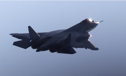 "FILE - In this file photo taken on  Wednesday, Aug. 17, 2011, a Russian twin-engine jet fighter T-50 flies over Zhukovsky airfield as it takes part in the MAKS-2011 International Aviation and Space Show, outside Moscow, Russia. Russia's first stealth fighter jet has had to abort takeoff at Moscow's International Aviation and Space Show.The T-50 did not leave the runway and was slowed by a brake parachute. The reason for Sunday's aborted takeoff was not immediately clear. Russian news agencies quoted air show officials as saying only that the reason was ""technical.""  (AP Photo/Mikhail Metzel)"