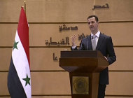 In this image made from video, Syrian President Bashar Assad delivers a speech in Damascus, Syria, Tuesday, Jan. 10, 2012. Assad gave his first speech Tuesday since he agreed last month to an Arab League plan to halt the government's crackdown on dissent. (AP Photo/Syrian State Television via APTN) SYRIA OUT
