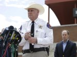 Kaufman County Sheriff David Byrnes speaks at a news conference, Sunday, March 31, 2013, in Kaufman, Texas. On Saturday, Kaufman County District Attorney Mike McLelland and his wife, Cynthia, were murdered in their home. (AP Photo/Mike Fuentes)