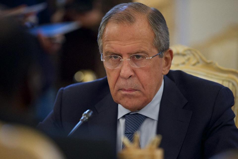 Russian Foreign Minister Sergey Lavrov, center, listens during his meeting with counterparts Ibrahim Gandour, from Sudan, and Benjamin Barnaba, from ...