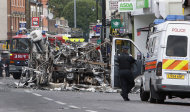 A burned bus is seen in Tottenham, north London, Sunday, Aug. 7, 2011 after a demonstration against the death of a local man turned violent and cars and shops were set ablaze. One police officer was hospitalized and seven others were injured during riots after a north London suburb exploded in anger Saturday night following a gathering to protest the Thursday shooting by police of the 29-year-old. (AP Photo/Akira Suemori)