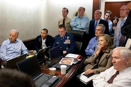 U.S. President Barack Obama (2nd L) and Vice President Joe Biden (L), along with members of the national security team, receive an update on the mission against Osama bin Laden in the Situation Room of the White House, May 1, 2011. REUTERS/White House/Pete Souza/Handout