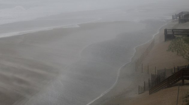 Wind and water whip across the beach as the effects of Hurricane Irene are felt in Nags Head, N.C., Saturday, Aug. 27, 2011 (AP Photo/Gerry Broome)
