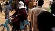 A still from a video taken with a mobile phone shows a convoy of Islamists patrolling the streets of Gao on June 26. An Islamist militant group in lawless northern Mali, MUJAO, Friday threatened countries that would join a military intervention force. (AFP Photo/)