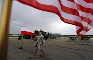 U.S. soldiers walk after a ceremony for the arrival of U.S. paratroopers from the U.S. Army's 173rd Infantry Brigade Combat Team based in Italy in Swidwin