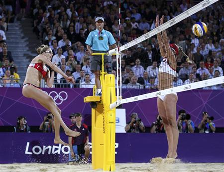 Kerri Walsh Jennings (L) of the U.S. spikes the ball past April Ross of the U.S. at the women's beach volleyball gold medal match at the Horse Guards Parade during the London 2012 Olympic Games August 8, 2012