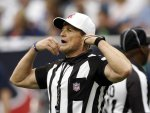 Referee Ed Hochuli gives the call in Houston