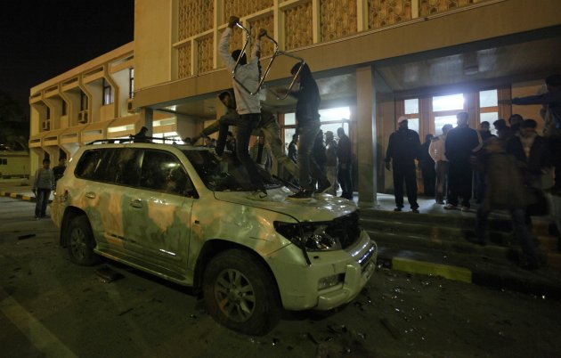 Libyans damage the car of National Transitional Council (NTC) Chairman Mustafa Abdel Jalil, to express their dissatisfaction towards the policy of the Council in governing the country, in Benghazi