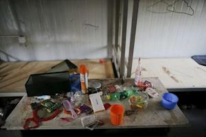 Possessions of a migrant worker are seen at his accommodation…