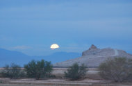 Moonset at Rock Hill, one of five volcanoes that comprise the Salton Buttes. The buttes last erupted between 940 and 0 B.C., not 30,000 years ago, as previously thought, a new study finds.