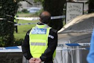 British police officer attends the scene after six people were killed in a knife attack, Sunday Aug. 14, 2011, in St Helier, Jersey, England. A man is reported to have been arrested Sunday on suspicion of fatally stabbing six people, including two young children, two men and two women, on the British island of Jersey, police said, and unidentified neighbors declared that the incident may have involved members of the same family. (AP Photo / Ian Le Sueur, PA) UNITED KINGDOM OUT - NO SALES - NO ARCHIVES
