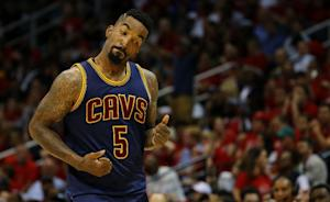 J.R. Smith of the Cleveland Cavaliers reacts after…