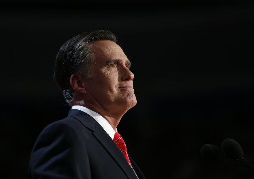 Republican presidential nominee Mitt Romney acknowledges delegates before speaking at the Republican National Convention in Tampa, Fla., on Thursday, Aug. 30, 2012. (AP Photo/Jae C. Hong)
