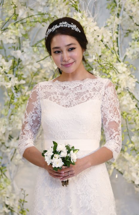 South Korean actress Lee poses during a photo call before her wedding in Seoul