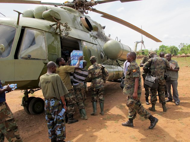In this photo of  Wednesday April 18, 2012 Ugandan troops load supplies to be sent to squads hunting for rebel leader Joseph Kony deep in the Central African Republic jungle. For Ugandan soldiers task