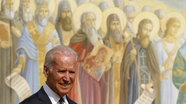 Joe Biden with Saints Mural in Background