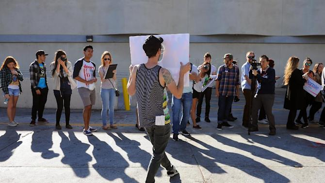 People wait in line to attend a rally for Democratic presidential candidate, Sen. Bernie Sanders, I- Vt., Wednesday, March 23, 2016, in Los Angeles. (AP Photo/Michael Owen Baker)