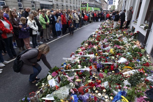 People gather to observe a minute's silence at noon in front of the Norwegian Embassy in Copenhagen, Monday, July 25, 2011. Anders Behring Breivik, the man who has confessed to Friday's twin attacks that killed 93 people in Norway, was arraigned in court Monday. (AP Photo/Polfoto/Jens Dresling) DENMARK OUT