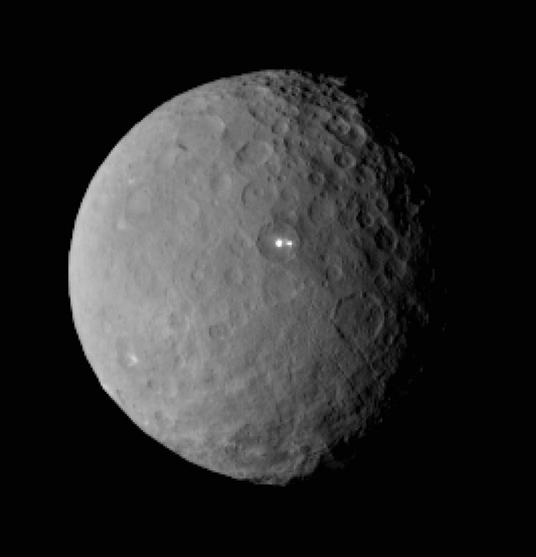 This Feb. 19, 2015 image shows the swarf planet Ceres provided by NASA, taken by the agency's Dawn spacecraft from a distance of nearly 29,000 miles (46,000 kilometers). It shows that the brightest spot on Ceres has a dimmer companion, which apparently lies in the same basin, seen at center of the image. Dawn is preparing to rendezvous with the largest object in the asteroid belt located between Mars and Jupiter, scheduled to go into orbit Friday, March 7 after a three-year journey. Dawn is about 590 miles (950 kilometers) in diameter. (AP Photo/NASA/JPL-Caltech/UCLA/MPS/DLR/IDA)