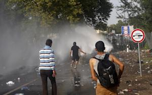"Hungarian police spray water on migrants at the ""Horgos …"