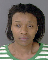 This undated photo provided by the Philadelphia Police Department shows Jean McIntosh, 32. McIntosh is a fourth person charged following the discovery of four malnourished mentally disabled adults chained to a boiler in a locked northeast Philadelphia basement room that was too small for an adult to stand up straight and also reeked of waste from the buckets they used to relieve themselves, police said Sunday, Oct. 16, 2011. (AP Photo/Philadelphia Police Department)