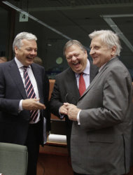Belgian Finance Minister Didier Reynders, left, and Greek Finance Minister Evangelos Venizelos, center, speak with European Central Bank President Jean-Claude Trichet during a round table meeting of eurozone finance ministers at the EU Council building in Brussels on Monday, July 11, 2011. European officials are trying to work out a strategy Monday to prevent the eurozone's debt crisis from spilling over into bigger economies such as Italy and Spain, as they discuss details of a second bailout for Greece. (AP Photo/Virginia Mayo)