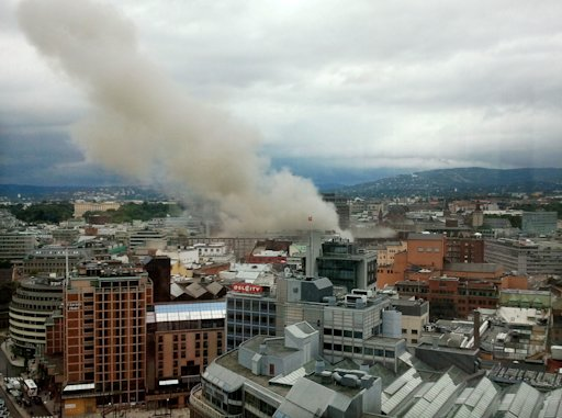 Smoke rises from the central area of Oslo Friday, July 22, 2011 after an explosion. Terrorism ravaged long-peaceful Norway on Friday when a bomb ripped open buildings including the prime minister's office and a man dressed as a police officer opened fire at a nearby island youth camp. (AP Photo/Scanpix, Jon Bredo Overaas)  NORWAY OUT