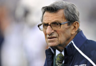 "FILE - In this Oct. 22, 2011 file photo, Penn State coach Joe Paterno stands on the field before his team's NCAA college football game against Northwestern, in Evanston, Ill. Paterno's doctors say that the former Penn State coach's condition has become ""serious,"" following complications from lung cancer in recent days. (AP Photo/Jim Prisching, File)"
