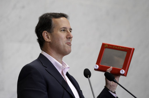 Republican presidential candidate, former Pennsylvania Sen. Rick Santorum holds an Etch A Sketch as he speaks to USAA employees during a campaign stop, Thursday, March 22, 2012, in San Antonio. (AP Photo/Eric Gay)
