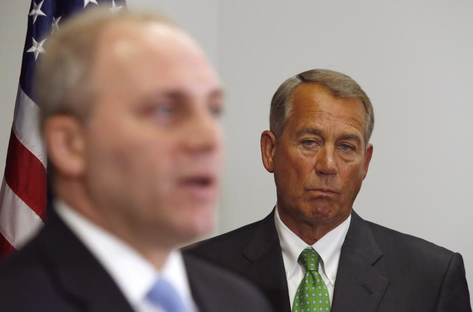 Boehner listens to remarks by Scalise at a news conference following a Republican caucus meeting at the U.S. Capitol in Washington