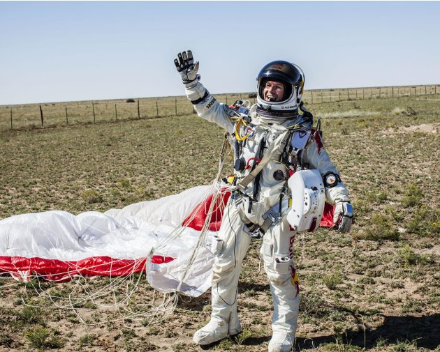 Pilot Felix Baumgartner of Austria celebrates after successfully completing the final manned flight for Red Bull Stratos in Roswell