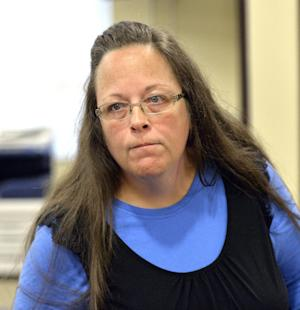 Rowan County Clerk Kim Davis listens to a customer …