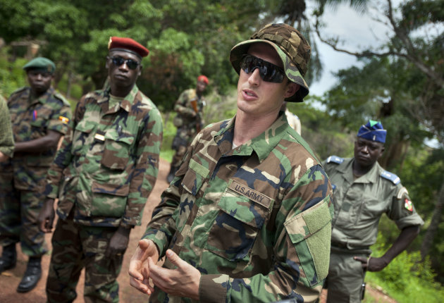 U.S. Army special forces Captain Gregory, 29, from Texas, center, who would only give his first name in accordance with special forces security guidelines, speaks with troops from the Central African