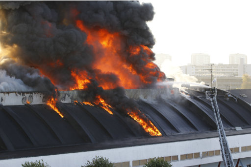 "The old-listed Sports Arena KB Hallen blazes as a fire broke out in the morning of the opening of the ""Erotic World Messe"" in Frederiksberg, Copenhagen, Denmark, Wednesday, Sept. 28. 2011. The hall was completed in 1938 and was then Europe's largest private sports facilities. (AP Photo/POLFOTO, Jens Dresling) DENMARK OUT"