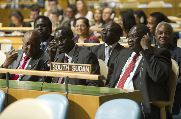 In this photo provided by the United Nations, members of the delegation of the Republic of South Sudan, led by Vice President Riek Machar Teny-Dhurgon, right, are seated in United Nations General Asse